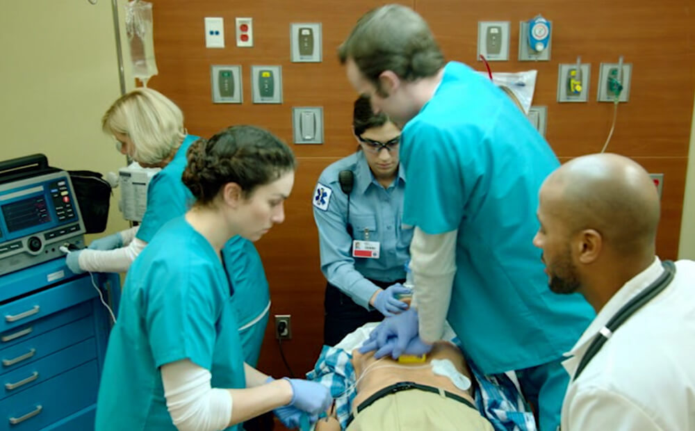 medical team working on patient in hospital