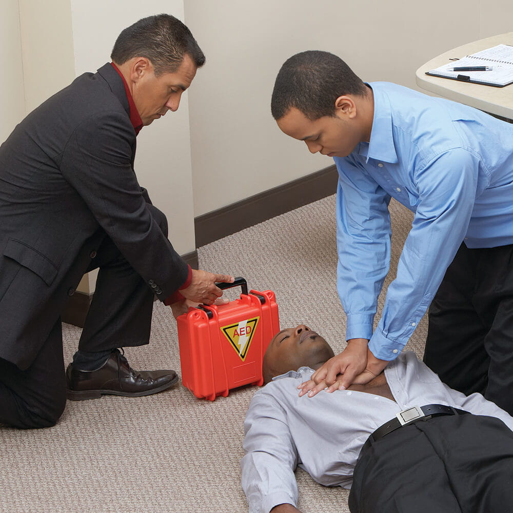 man performing CPR in workplace