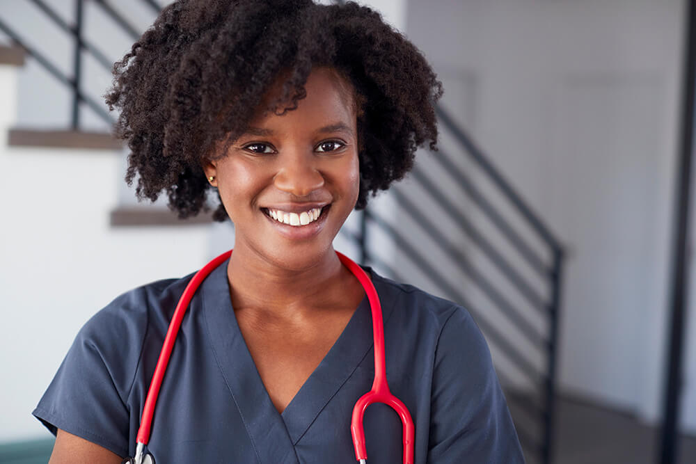 smiling female nurse wearing scrubs